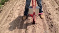 Engineer Demonstrates Prototype Hand Planter