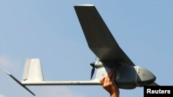 FILE - A Raven drone is pictured at the U.S. military base in Vilseck-Grafenwoehr, Germany, Oct. 8, 2013.