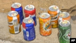 Locally made explosives found in a car are displayed along a road in Nigeria's northern city of Kano.