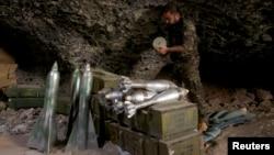 A Free Syrian Army fighter prepares ammunition inside a cave in Maaret al-Naaman village, in Idlib, Syria, Oct. 17, 2013.