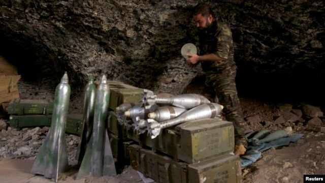 A Free Syrian Army fighter prepares ammunition inside a cave in Maaret al-Naaman village, in Idlib, Syria, Oct. 17, 2013.