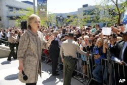 Democratic presidential candidate Hillary Clinton addresses supporters in the overflow area during a campaign event at the Los Angeles Southwest College, in Los Angeles, April 16, 2016.