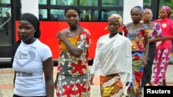 FILE - Girls who escaped from their Boko Haram captors arrive at the presidential villa in Abuja, July 22, 2014.