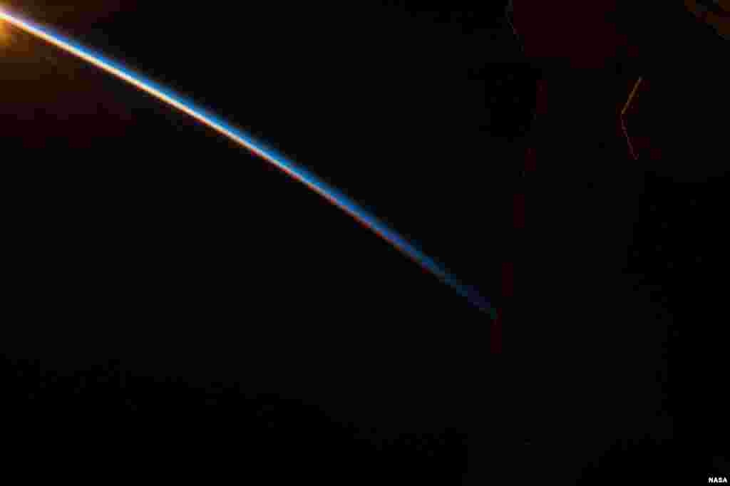 Earth's thin atmosphere stands out against the blackness of space in this photo shared by NASA astronaut Scott Kelly on board the International Space Station.