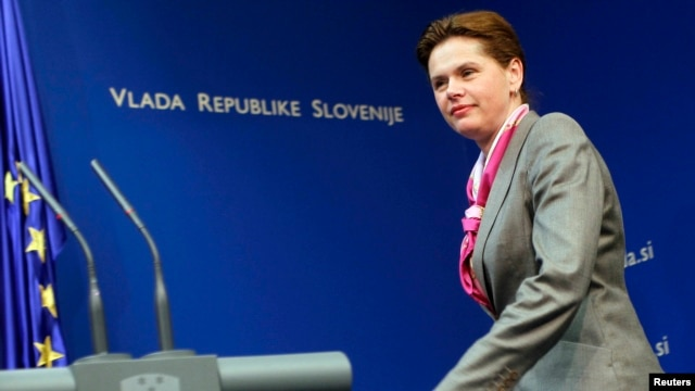 FILE - Alenka Bratusek arrives during a news conference in Ljubljana.