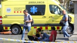 Assistance à un blessé, Barcelone, Espagne, le 17 août 2017.