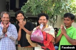 "FILE- Ouch Leng (third from the left), winner of Goldman Environmental Prize 2016, and three other environmental activists were released after being detained for ""trespassing"" in the Prey Lang protected area. (Courtesy photo of CCHR)"