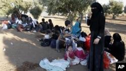 Izbeglice iz Sirije na granici sa Jordanom