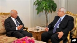 In this image released by the Egyptian Presidency, interim President Adly Mansour, right, meets with Hazem el-Beblawi, left, in Cairo, Egypt, Tuesday, July 9, 2013. The spokesman of Egypt's interim president says a prominent economist, Hazem el-Beblawi, h