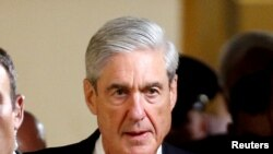 FILE - Special Counsel Robert Mueller on Capitol Hill in Washington.
