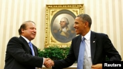 FILE - President Barack Obama shakes hands with Pakistan's Prime Minister Nawaz Sharif in the Oval Office at the White House in Washington, Oct. 23, 2013.
