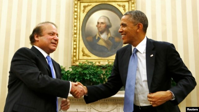U.S. President Barack Obama shakes hands with Pakistan's Prime Minister Nawaz Sharif in the Oval Office at the White House in Washington, Oct. 23, 2013.