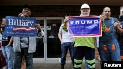 Supporters of U.S. Democratic presidential candidate Hillary Clinton and Republican presidential Donald Trump