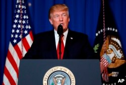 FILE - U.S. President Donald Trump speaks after the U.S. fired a barrage of cruise missiles into Syria Thursday night in retaliation for this week's gruesome chemical weapons attack against civilians, at Mar-a-Lago in Palm Beach, Florida, April 6, 2017.