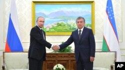 Rusiya prezidenti Vladimir Putin və Özbəkistanın Baş naziri Şovkat Mirziyoyev