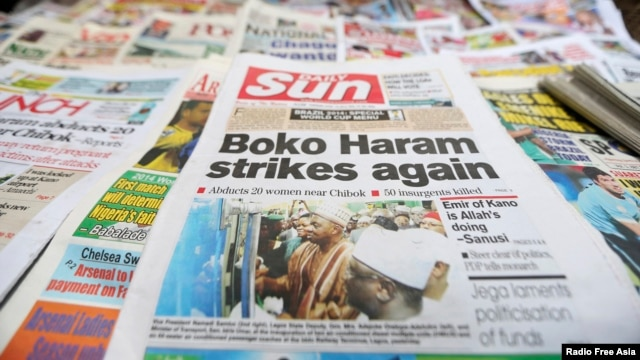 A newspaper with its frontpage headline on an abduction of women from a village in northeast Nigeria is displayed at a vendor's stand along a road in Ikoyi district in Lagos, Nigeria, June 10, 2014.