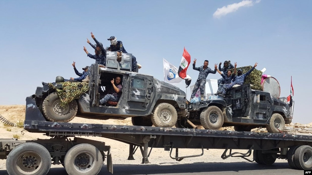 A handout picture released by the Iraqi Federal Police on Aug. 15, 2017, shows Iraqi armored units headed for the town of Tal Afar, the main remaining Islamic State stronghold in the northern part of the country. Iraqi warplanes carried out airstrikes against IS group positions in Tal Afar in preparation for a ground assault.
