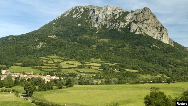 The village and Peak of Bugarach, the highest point of the Corbieres massif, in southwestern France, is seen June 24, 2011.
