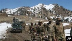 In this picture taken March 8, 2011, Pakistan army soldiers are shown on patrol in the Pakistani tribal area of Ditta Kheil in North Waziristan, where the Pakistan army is fighting Islamic militants along the Afghanistan border.