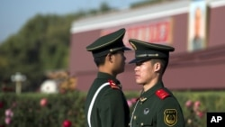 Chinese paramilitary policemen stand guard near Tiananmen Gate in Beijing, November 1, 2012.