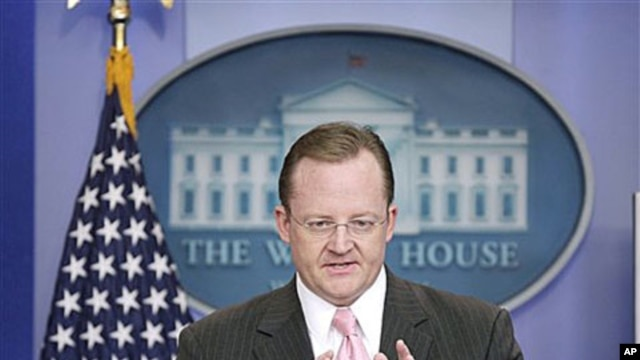 White House Press Secretary Robert Gibbs gestures during his daily news briefing at the White House in Washington, Nov., 30, 2010