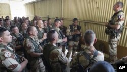 This picture released by the French Army shows French soldiers of the 21st Marine Infantry Regiment during a briefing before flying to Bamako, the capital from Mali, at the N'Djamena airport in Chad, Jan. 11, 2013.