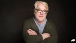 FILE - Philip Seymour Hoffman poses for a portrait during the Sundance Film Festival, in Park City, Utah, Jan. 19, 2014.