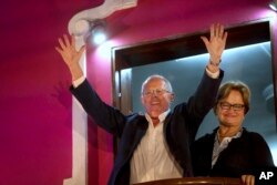 FILE - Presidential candidate Pedro Pablo Kuczynski greets supporters from the balcony of his party's headquarters next to his wife Nancy Lange in Lima, Peru, June 5, 2016.
