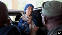 FILE - Liberia's President Ellen Johnson Sirleaf arrives at the Capitol to address lawmakers in Monrovia, Liberia.
