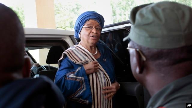 FILE - Liberia's President Ellen Johnson Sirleaf arrives at the Capitol to address lawmakers in Monrovia, Liberia.