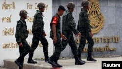 Thai Army officers walk outside the military barracks believed to be holding two arrested bomb suspects involved in the recent Bangkok blast in Bangkok, Thailand, September 2, 2015.