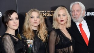 "Actors, from left, Jena Malone, Natalie Dormer, Jennifer Lawrence and Donald Sutherland attend a special screening of ""The Hunger Games: Mockingjay Part 2,"" Nov. 18, 2015, in New York."