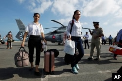 FILE PHOTO -Cambodian medical officers arrive for health checks on passengers and crew of the cruise ship Westerdam in Sihanoukville, Cambodia, Thursday, Feb. 13, 2020. (AP Photo)