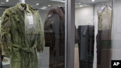 The clothing of the six Jesuits who were killed during El Salvador's 1980-1992 civil war are exhibited at the Museum of the Central American University in San Salvador, (File)