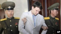 American student Otto Warmbier, center, is escorted at the Supreme Court in Pyongyang, North Korea in March. He was sentenced to 15 years in prison with hard labor.