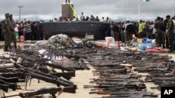 Police display weapons collected from Niger delta militants as part of a government amnesty program, Yenagoa, August 2009.