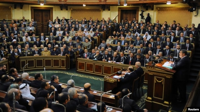 Egyptian President Mohamed Mursi delivers a speech to the Shura Council, or upper house of parliament, in Cairo, December 29, 2012.