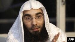 FILE - 'Sharia4Belgium' spokesman Fouad Belkacem speaks during a press conference in Sint-Jans-Molenbeek in Brussels, on June 1, 2012.