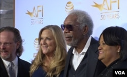 Actor Morgan Freeman (2-R) is seen in a group photo with guests attending an event marking 50 years of joint film preservation efforts between the American Film Institute and the Libary of Congress.