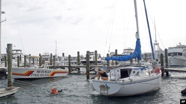 Craig Jones, left, and Kimberly Branson secure their boat in Key West, Fla., in preparation for Tropical Storm Isaac, August 26, 2012.
