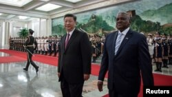 China's President Xi Jinping and President of Botswana Mokgweetsi Masisi review the Chinese People's Liberation Army honor guard during the welcome ceremony at the Great Hall of the People in Beijing, Aug. 31, 2018.