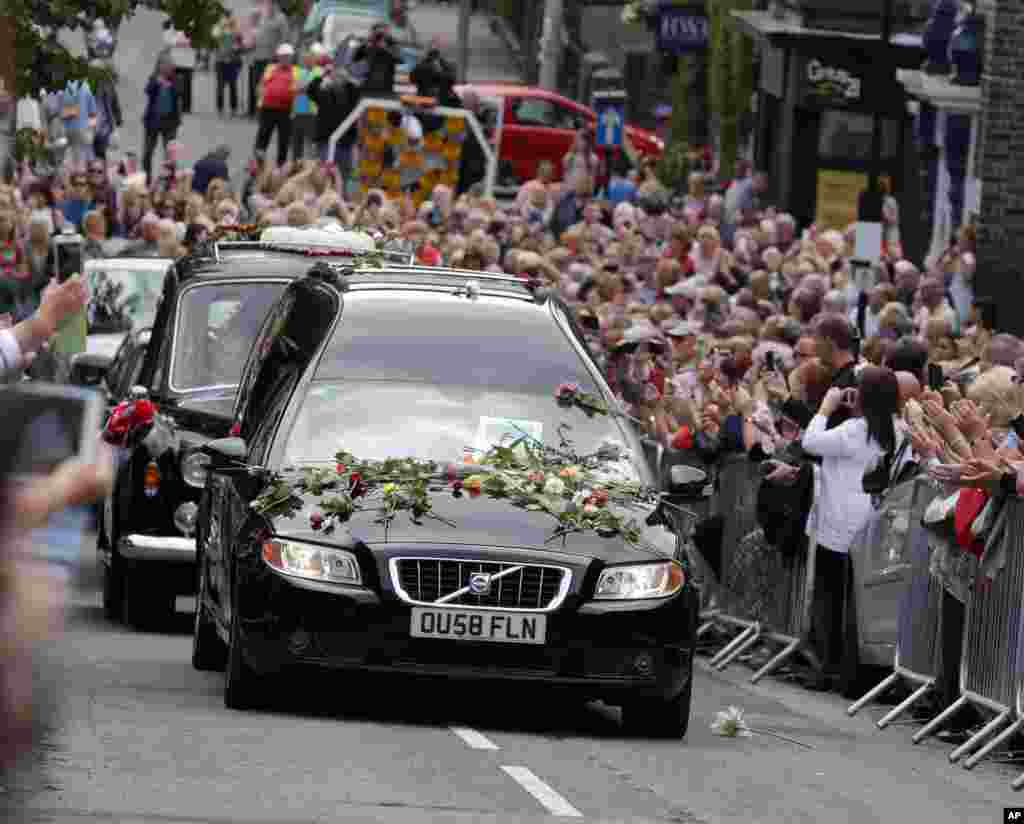 The funeral cortege of British singer and TV personality Cilla Black makes its way to St. Mary's Church in Liverpool, England. Cilla Black, 72, died in Spain on Aug. 1, 2015.