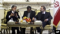 Iran's parliament speaker Ali Larijani (r) meets with Brazil's Foreign Minister Celso Amorim (l) in Tehran, 26 Apr 2010