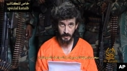 In this undated image from a video posted on Islamic militant websites and made available on June 9, 2010, a man identified as French security agent Denis Allex pleads for his release from the Somali militant group al-Shabab.
