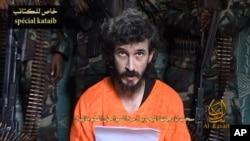 Hoton dan Faransa kennan wanda ake kira Dennis Allex a hoton da shafin al-Shabab ya wallafa ran Yuli 9 2010