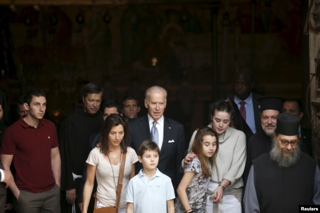 U.S. Vice President Joe Biden, center, and his family members stand at the entrance to the Church of Holy Sepulchre in Jerusalem's Old City, March 9, 2016.
