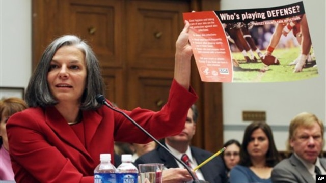 FILE - U.S. Centers for Disease Control (CDC) Director Julie Gerberding holds up a staph awareness poster while testifying before the House Committee on Oversight and Government Reform Committee hearing on drug-resistant infections and the consequences for public health, on Capitol Hill in Washington, November 2007.