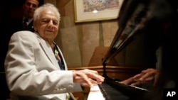FILE - Irving Fields, New York City's oldest cabaret singer and piano player, plays the piano during a 100th birthday celebration for him at Nino's Tuscany restaurant, Aug. 7, 2015.
