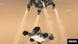 Gambar konsep pendaratan pesawat penjelajah angkasa NASA, Curiousity, ke permukaan planet Mars (NASA/JPL-Caltech). Pesawat ini dijadwalkan akan mendarat di Mars Senin dini hari (6/8) waktu Amerika.