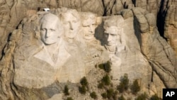 FILE - Mount Rushmore National Memorial in the Black Hills of South Dakota. Millions of workers and school children in the United States have the day off Monday for the annual Presidents' Day holiday.